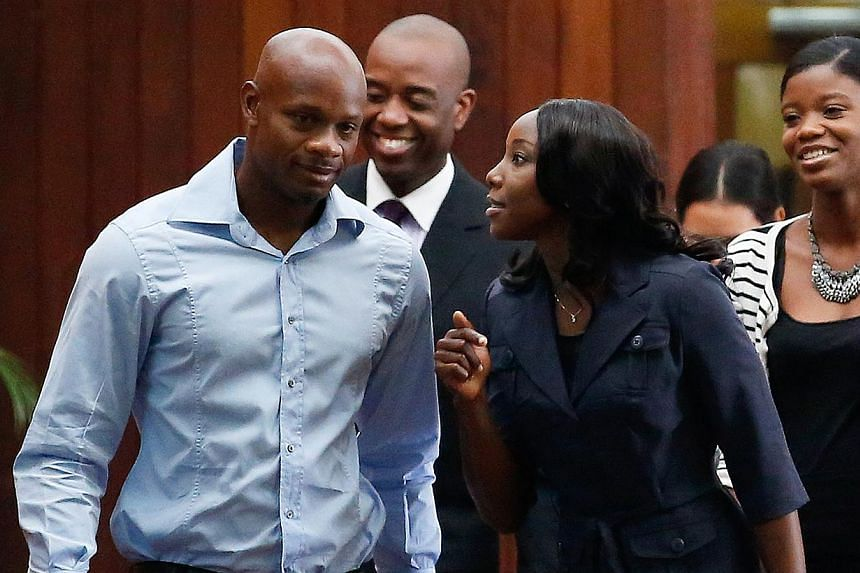 Jamaica's Olympic sprinter Sherone Simpson (right), who tested positive for doping at the Jamaican Championships in 2013, talks with former 100m world record holder Asafa Powell as she arrives for the second day the hearing before the country's anti-
