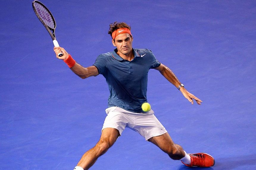 Roger Federer of Switzerland hitting a forehand return during a charity match against Jo-Wilfried Tsonga of France in Melbourne on Jan 8, 2014. Federer says he feels a return to top form could be months away but he is in good shape for a tilt at