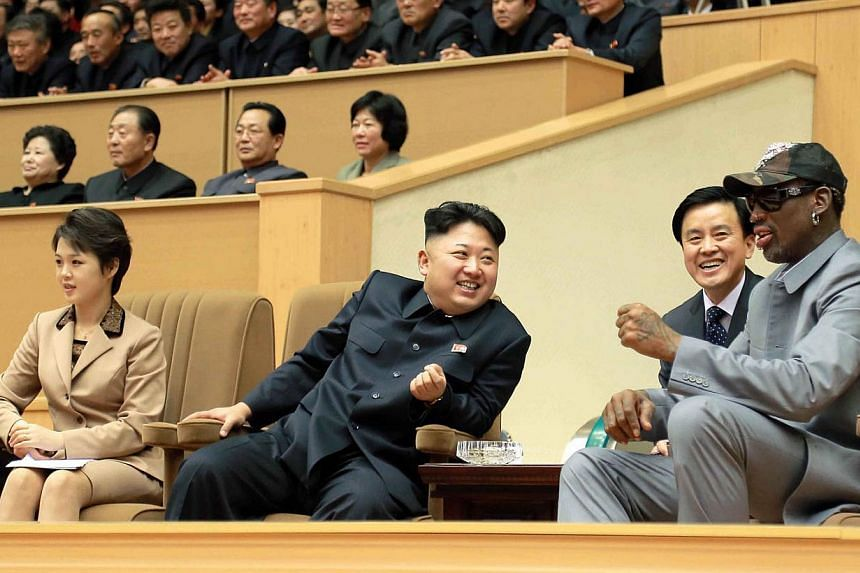 North Korean leader Kim Jong Un (second left) watches a basketball game between former US NBA basketball players and North Korean players of the Hwaebul team of the DPRK with Dennis Rodman (right) at Pyongyang Indoor Stadium in this undated photo rel