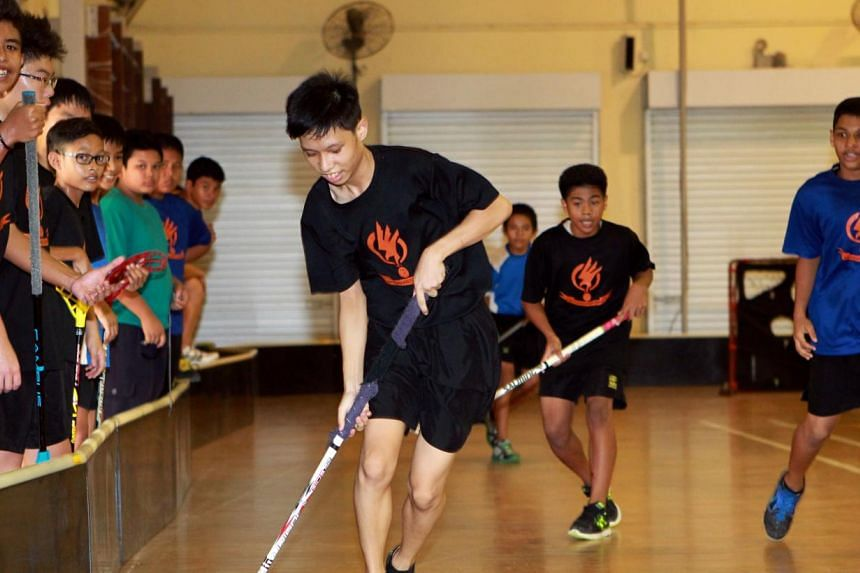 Northbrooks Secondary School students playing floorball as part of their co-curricular activity. Secondary 1 students this year will have an updated grading system to calculate their co-curricular programme points. -- ST FILE PHOTO: SEAH KWANG PENG