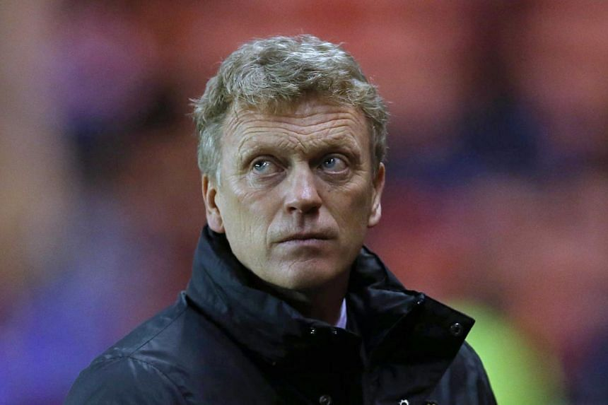 Manchester United's Scottish manager David Moyes is pictured before the start of a League Cup semi-final first leg match between Sunderland and Manchester Utd at the Stadium of Light in Sunderland, in north-east England, on Jan 7, 2014. -- PHOTO: AFP