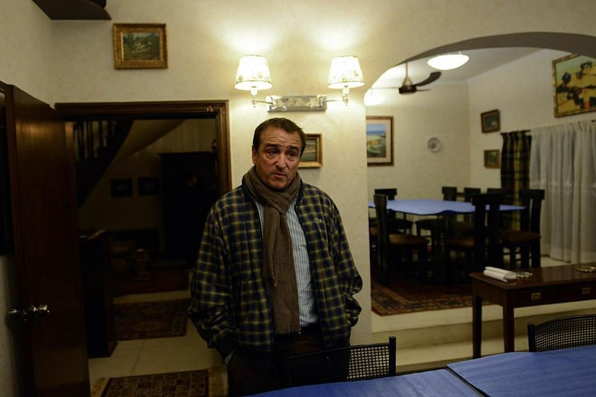 """Mr Philippe Lafforgue, French owner of the restaurant """"La Maison"""" which serves non-halal food, speaks during an interview with AFP at his restaurant in Islamabad on Jan 7, 2014. With coarse-grained pork sausages, blood pudding and fine wine on hi"""