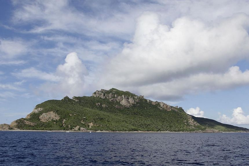 A group of disputed islands known as Senkaku in Japan and Diaoyu in China are seen from the city government of Tokyo's survey vessel in the East China Sea in this Sept 2, 2012 file photo. -- FILE PHOTO: REUTERS