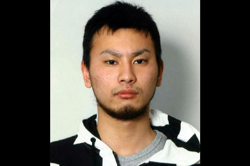 This recent picture released by Kanagawa Prefectural Police Department on January 7, 2014 shows a portrait of escaped rape suspect Yuta Sugimoto, 20. Sugimoto slipped away from his guard during a visit to prosecutors in an office building on January