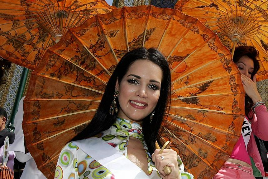 Miss Venezuela Monica Spear visits the Grand Royal Palace in Bangkok, on May 11, 2005, ahead of the Miss Universe beauty contest. A single bullet killed Spear in a double murder that also claimed her British partner and highlighted the country's viol