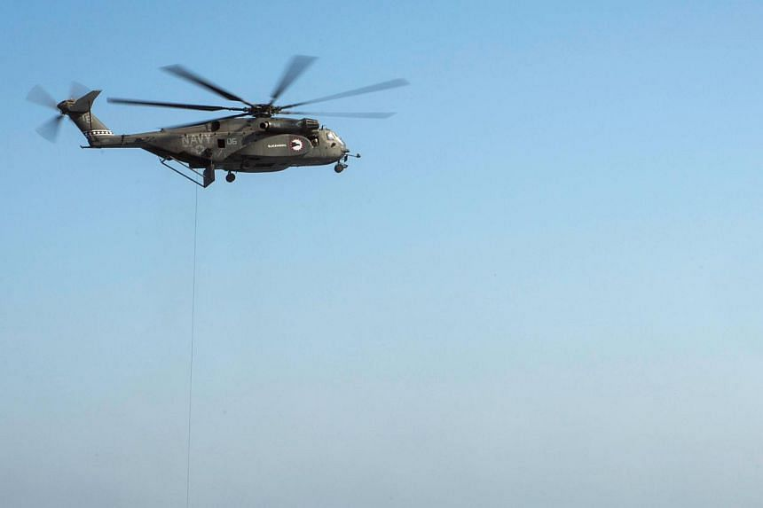 This Nov 11, 2013 United States(US) Navy handout image shows an MH-53 Sea dragon.A US Navy helicopter crashed off the coast of Virginia on Wednesday, leaving one crew member dead and another missing, officials said. -- FILE PHOTO: AFP