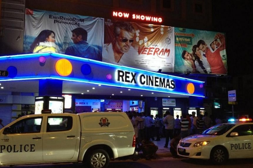 A crowd of more than 100 people, mostly foreign workers, refused to leave Rex Cinemas at Mackenzie Road, after the theatre cancelled the premiere of a movie on Thursday night, Jan 9, 2014.-- ST PHOTO: TESSA WONG