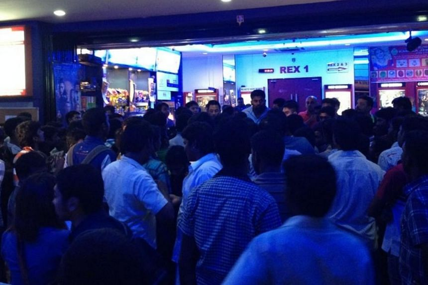 A crowd of more than 100 people, mostly foreign workers, refused to leave Rex Cinemas at Mackenzie Road, after the theatre cancelled the premiere of a movie on Thursday night.-- ST PHOTO: TESSA WONG