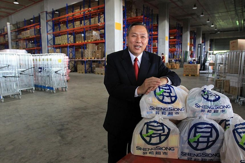 Sheng Siong CEO Lim Hock Chee at the company's warehouse and distribution centre at Mandai Link in 2011.The name Sheng Siong might be synonymous with supermarkets today, but the family behind it has its roots in pig farming.-- FILE PHOT
