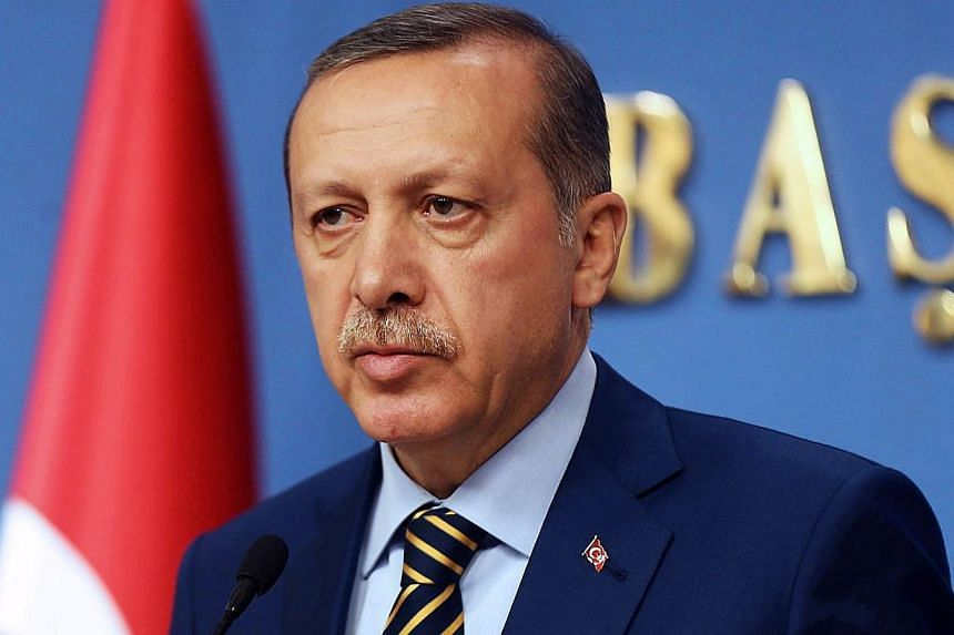 Turkish Prime Minister Tayyip Erdogan's ruling party has seen its popularity slip since a corruption scandal erupted last month but remains comfortably ahead of the main opposition, the first major poll published since the affair showed on Thursday,