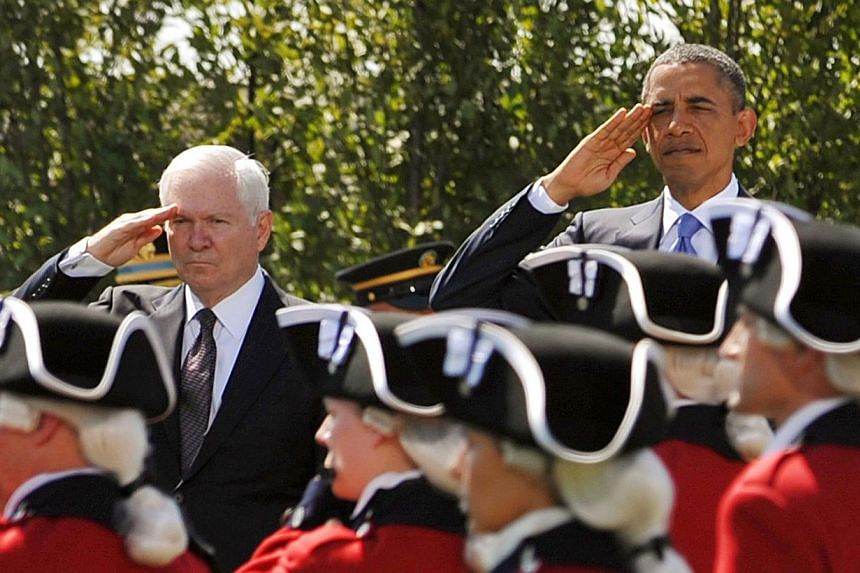 United States (US) President Barack Obama (right) and then outgoing US Defense Secretary Robert Gates salute troops during the Armed Forces Farewell Tribute to honour Mr Gates on June 30, 2011 at the Pentagon in Washington, D.C. The White House