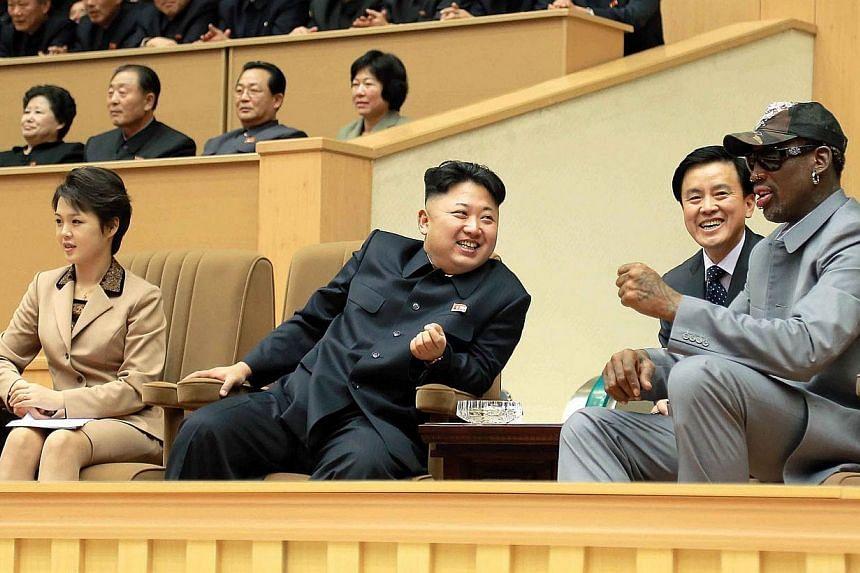 North Korean leader Kim Jong Un (centre), his wife Ri Sol Ju (left) and former United States basketball star Dennis Rodman watch a basketball game between former National Basketball Association players and North Korean players at Pyongyang Gymnasium