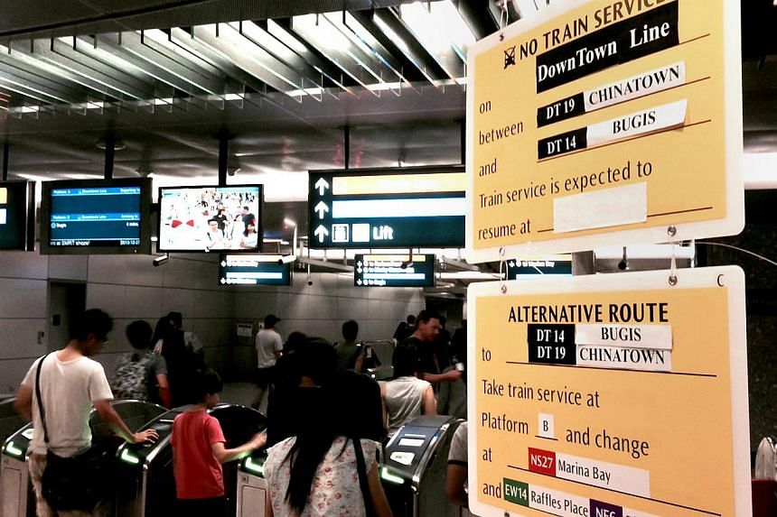Signages put up at Bayfront station, informing passengers of the Downtown Line train disruption on Dec 27, 2013. The number of train delays last year has gone down compared to 2012, based on latest figures from the Land Transport Authority.  --