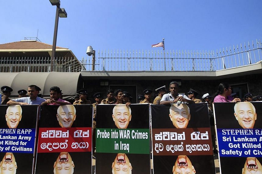 Members of the Federation of National Organization (FNO) gather in front of the US Embassy during a protest in Colombo January 9, 2014. The protesters are demonstrating against a visit by US Ambassador-at-Large, Office of Global Criminal Justice, Ste