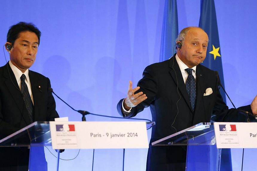 French Foreign Minister Fabius and his Japanese counterpart Kishida attend a news conference at the Quai d'Orsay ministry in Paris. -- PHOTO: REUTERS