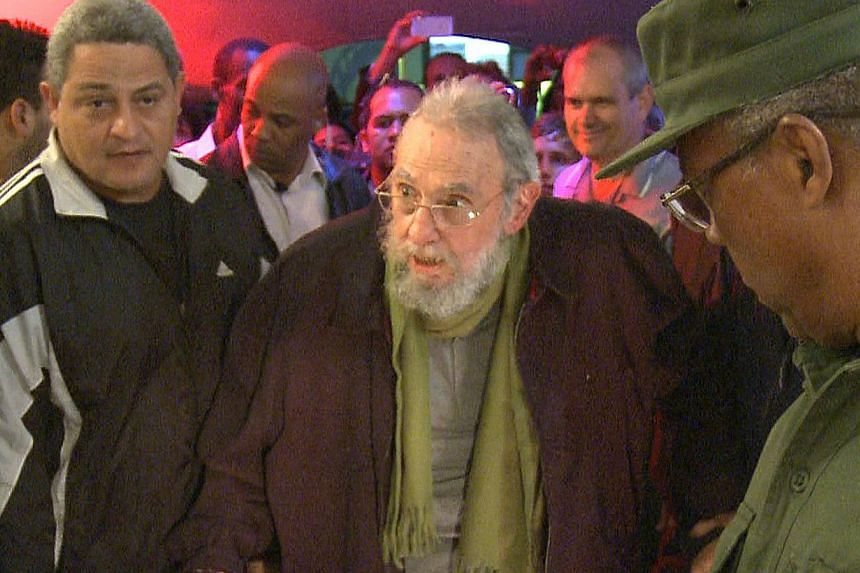 Still grab from a video taken on Jan 8, 2014, of former Cuban President Fidel Castro attending the inauguration of the nonprofit cultural centre Kcho Romerillo, Laboratory for Art in Havana. Mr Castro has appeared in public for the first time in nine