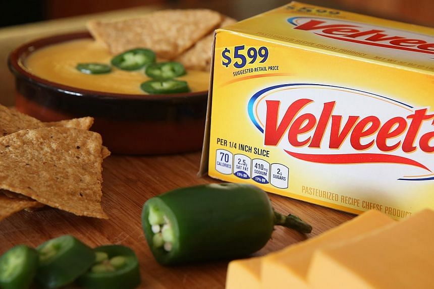 Velveeta cheese is shown on Jan 8, 2014 in Chicago, Illinois. The world's largest food and beverage companies have far exceeded a five-year goal set in 2010 to fight obesity by removing trillions of calories from products sold in the United States, a
