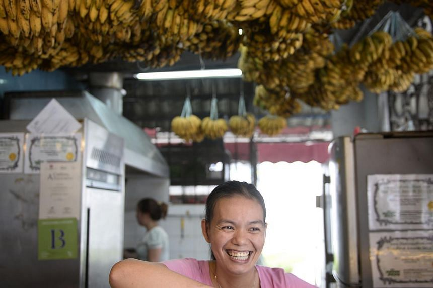 Mrs Rose Boon, 35, owner of Boon Pisang Goreng, says she will miss the place. Her shop is one of four from the original Long House in Jalan Besar that remain.-- ST PHOTOS: NEO XIAOBIN