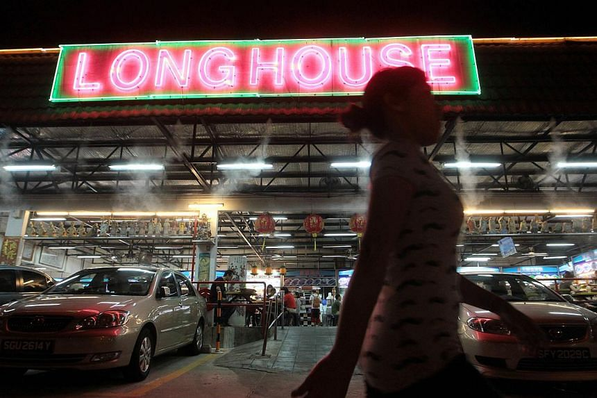 The Long House site in Upper Thomson Road was sold to TEE Land for $45.2 million earlier this week. The popular food centre moved here from Jalan Besar Stadium about 13 years ago. -- ST PHOTOS: NEO XIAOBIN