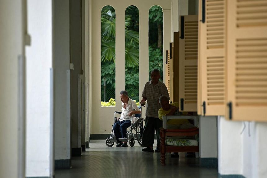 Elderly residents at St Theresa's Home. Senior Minister of State for Health and Manpower Amy Khor gave details of the new standards during her visit to the home yesterday. -- ST PHOTO: KUA CHEE SIONG