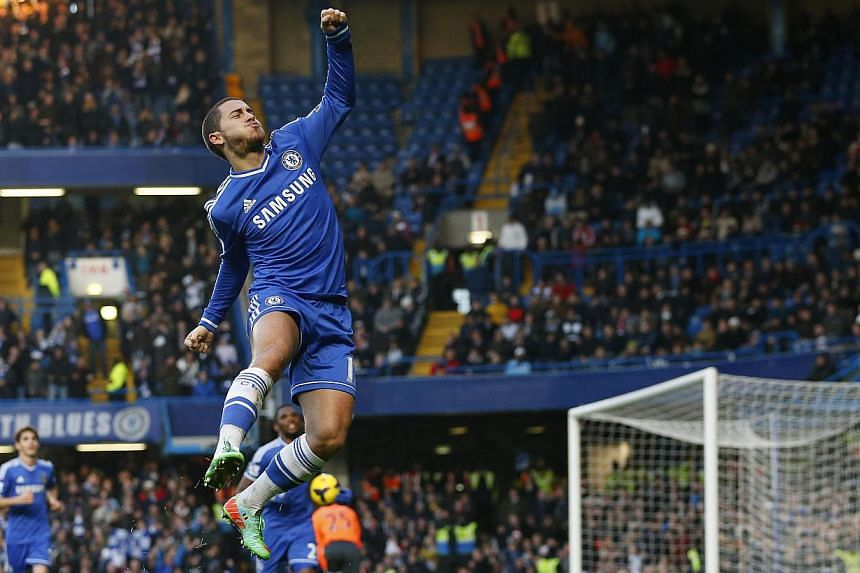 Chelsea's Eden Hazard celebrating scoring against Swansea on Dec 26. SingTel mio TV is committing to screening selected EPL matches weekly at 23 CCs till May 11, the season's final day. -- PHOTO: REUTERS