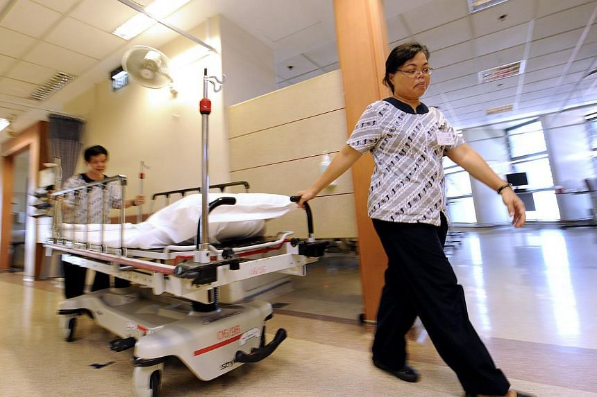 In 2010, Tan Tock Seng Hospital placed temporary beds in its corridors and also transferred 80 stable patients to Ren Ci Community Hospital next door. -- ST FILE PHOTO