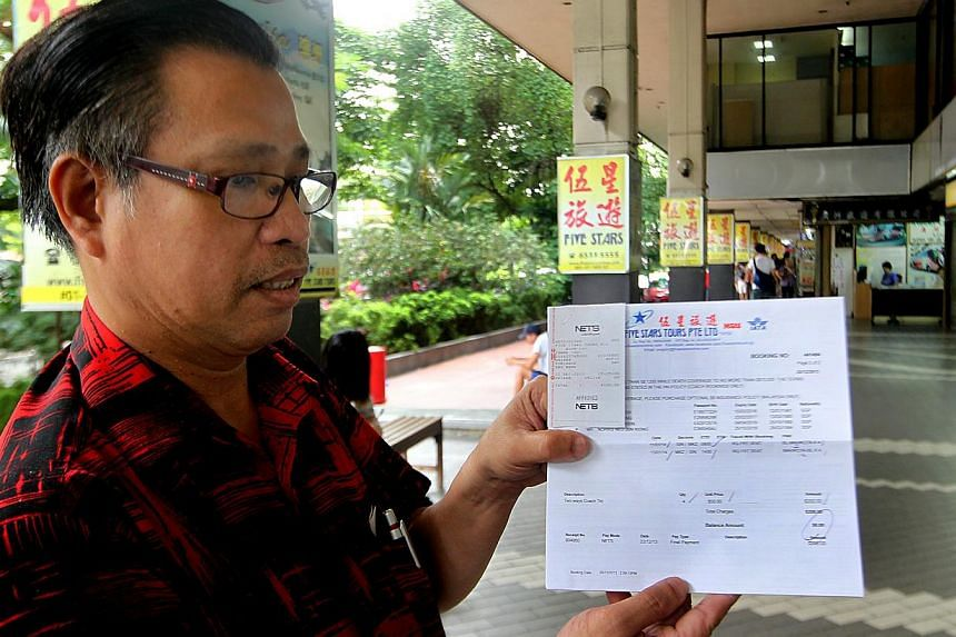 Mr Neo Tiong Poh (above) had booked a family trip to Malacca for tomorrow but has been left in the lurch.-- ST PHOTOS: LAU FOOK KONG