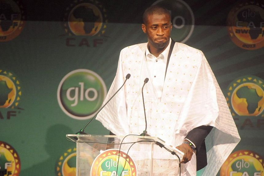 Manchester City midfielder Yaya Toure speaks after being declared winner of CAF African Footballer of the Year Award in Lagos, on Jan 9, 2014. -- PHOTO: AFP