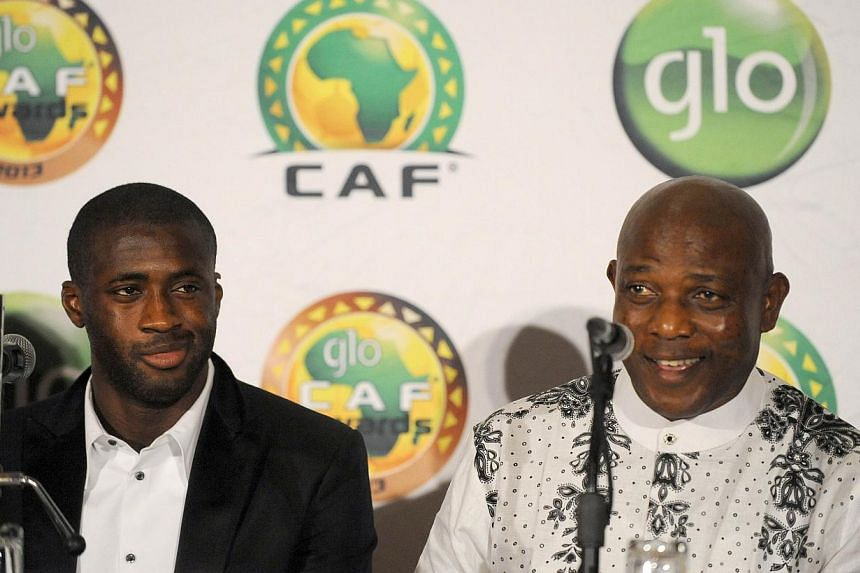 Nigerian Coach Stephen Keshi (right) who was declared African Coach of the Year speaks sitting beside Manchester City midfielder Yaya Toure, the winner of CAF African Footballer of the Year Award in Lagos, on Jan 9, 2014. -- PHOTO: AFP