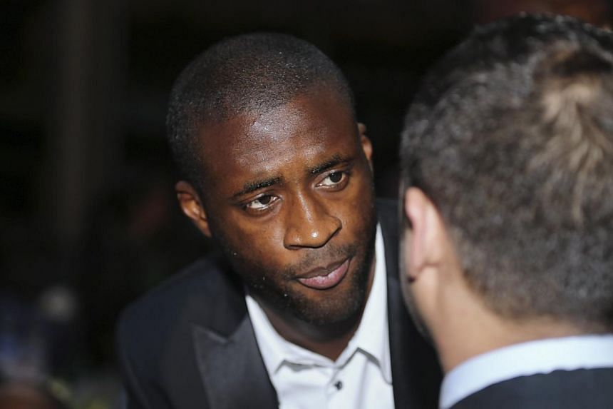 Manchester City and Ivory Coast midfielder Yaya Toure speaks with a guest at the 2013 Confederation of African Football (CAF) Awards in Lagos on Jan 9, 2014. -- PHOTO: REUTERS