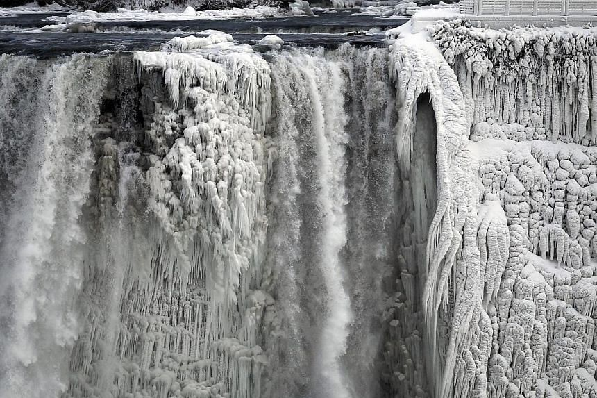 The US side of the Niagara Falls is pictured in Ontario, on Jan 8, 2014. The record-breaking cold spell in the US has frozen parts of the Niagara Falls, inspiring a flurry of photo-sharing across the world as photographers brave sub-zero temperatures