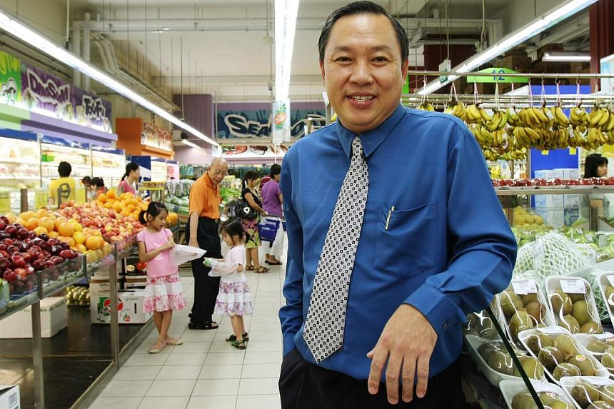 Mr Lim Hock Chee in a photo from 2009. The Sheng Siong CEO is a former farm boy and Jurong Vocation Institute graduate-turned-supermarket tycoon. -- ST FILE PHOTO: NURIA LING