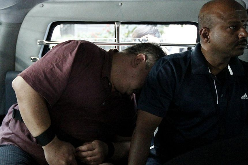 Heng Chen Boon (left), 50, one of the two men allegedly behind Wednesday's kidnapping for ransom. The men were lovers who have been living together for more than 10 years. -- ST PHOTO: WONG KWAI CHOW