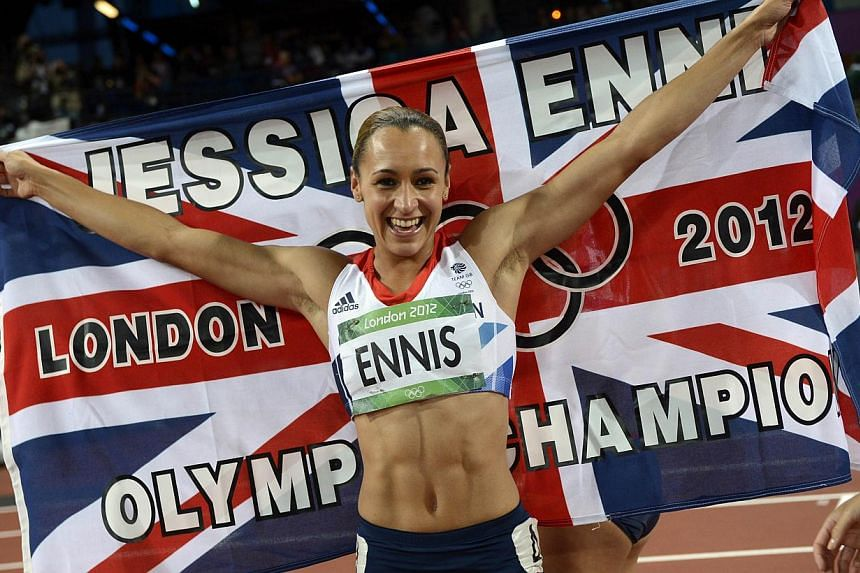 Britain's Jessica Ennis-Hill celebrates after winning the women's heptathlon at the athletics event of the London 2012 Olympic Games. Ennis-Hill is pregnant and will miss the Commonwealth Games in Glasgow in July but hopes to defend her Olympic hepta