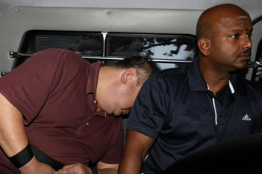 Lee Sze Yong (not pictured), 41, and Heng Cheng Booon (in brown shirt), 50, are accused of kidnapping Madam Ng Lye Poh on Wednesday, according to court documents seen by The Straits Times. -- ST PHOTO: WONG KWAI CHOW