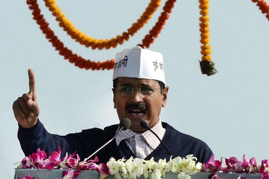 Anti-corruption champion and Aam Admi (Common Man) Party Leader and new Chief Minister of India's national capital region Arvind Kejriwal gestures as he addresses supporters after taking his oath of office at a ceremony in New Delhi, on Dec 28, 2013.