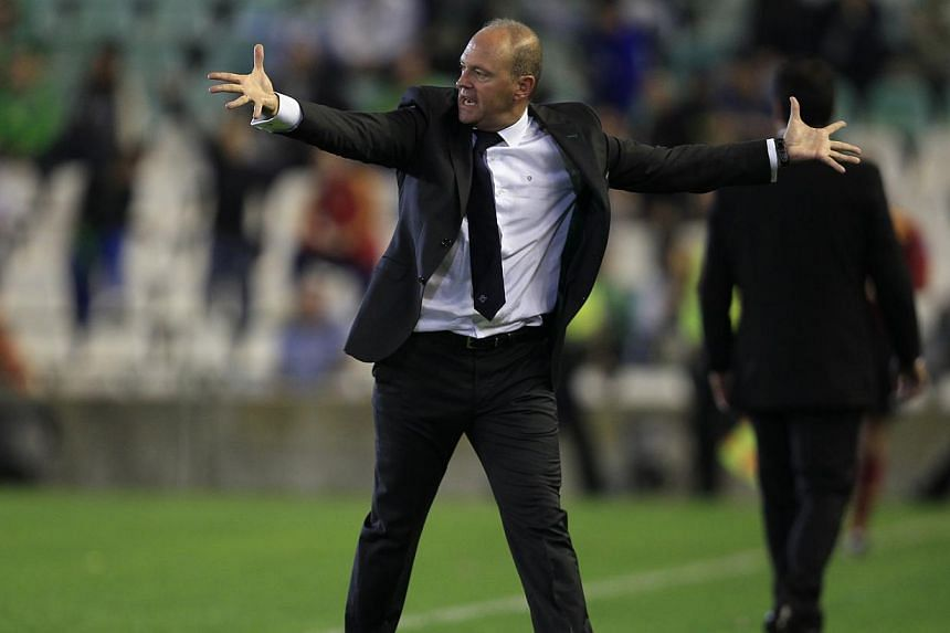 Real Betis' coach Pepe Mel reacts during the Europa League soccer match against Vitoria Guimaraes in Seville on Oct 24, 2013.West Bromwich Albion appointed former Mel as their new head coach on Jan 9, 2014, the English Premier League club annou
