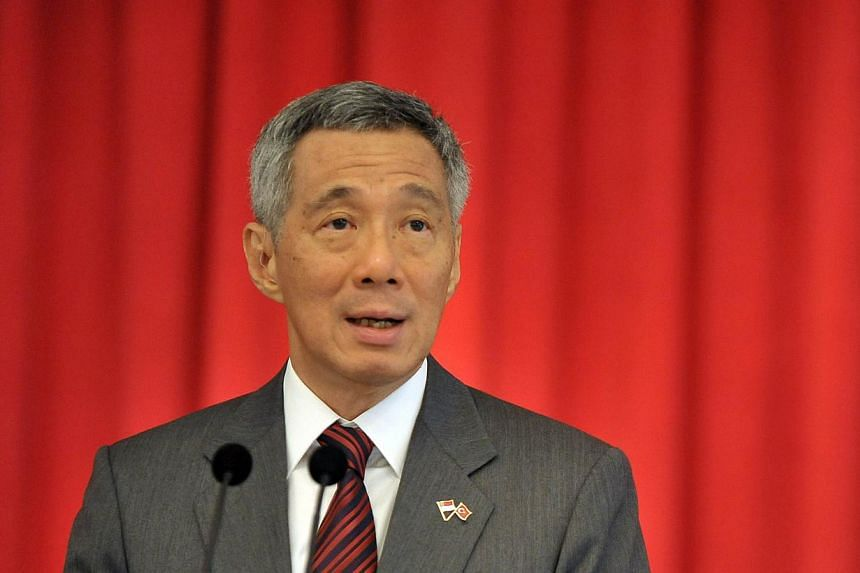 Prime Minister Lee Hsien Loong commends the police for the swift arrest of two suspects involved in the kidnapping of Madam Ng LyePoh, who is the mother of Sheng Siong supermarket chain chief executive Lim Hock Chee. -- FILE PHOTO: AFP