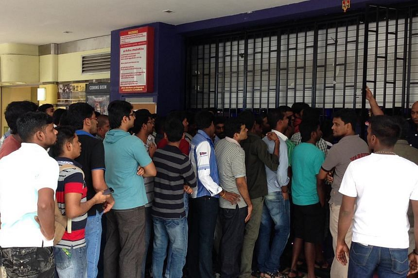 Close to a hundred movie goers wait outside the Rex cinema gate at 10.30am on Friday, Jan 10, 2013. -- ST PHOTO: YEO SAM JO