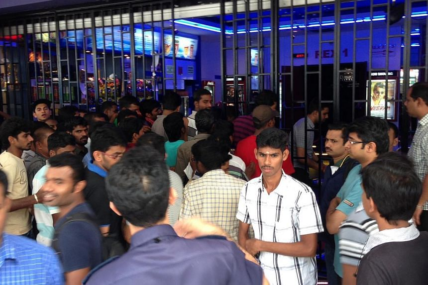 Viewers enter Rex Cinemas as the shutter are opened at 11am on Friday, Jan 10, 2013.More than 100 viewers finally got to watch Tamil blockbuster Veeram on Friday after Rex Cinemas abruptly cancelled the premiere on Thursday evening because the