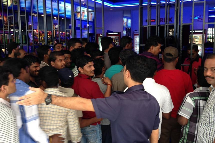 Viewers enter Rex Cinemas at 11am on Friday, Jan 10, 2013.More than 100 viewers finally got to watch Tamil blockbuster Veeram on Friday after Rex Cinemas abruptly cancelled the premiere on Thursday evening because the theatre could not gain per