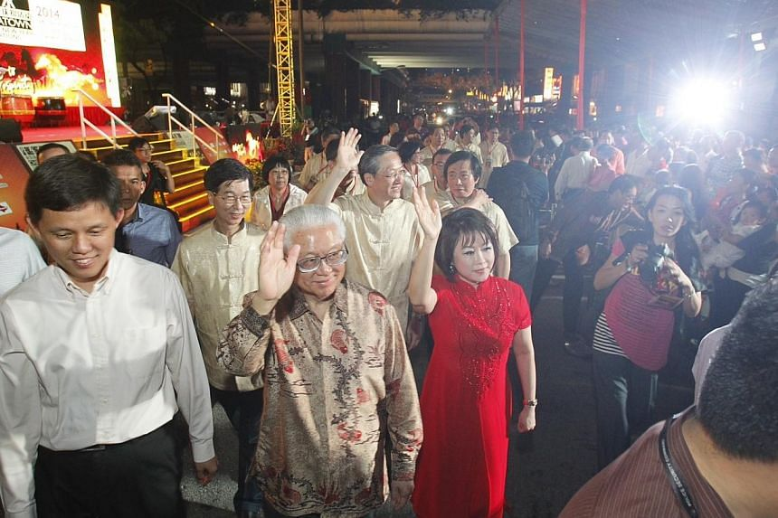 Minister for Social and Family Development Chan Chun Sing, President Tony Tan Keng Yam and MP for Tanjong Pagar GRC Lily Neo arriving at Chinatown Chinese New Year Light-Up and Opening Ceremony on Jan 11, 2014. -- ST PHOTO: KEVIN LIM
