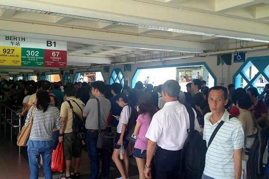 At Choa Chu Kang. SMRT has deployed free bus services to ferry passengers between Woodlands and Yew Tee train stations along the North-South line after it detected a track fault on Saturday. -- PHOTO: IZZUL HAZIQ