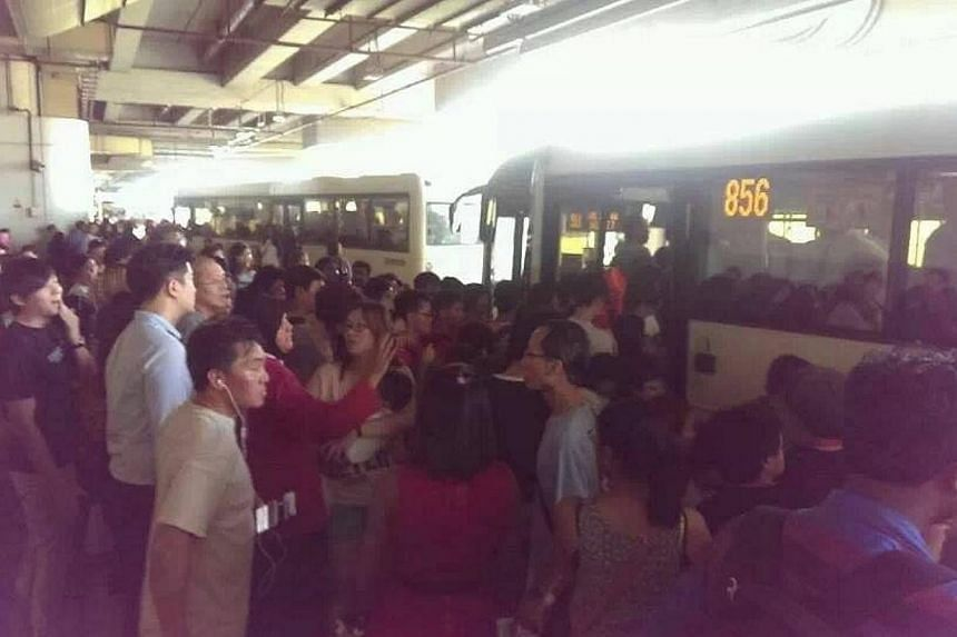 At Woodlands: SMRT has deployed free bus services to ferry passengers between Woodlands and Yew Tee train stations along the North-South line after it detected a track fault on Saturday. -- PHOTO: LEE BING XIAN