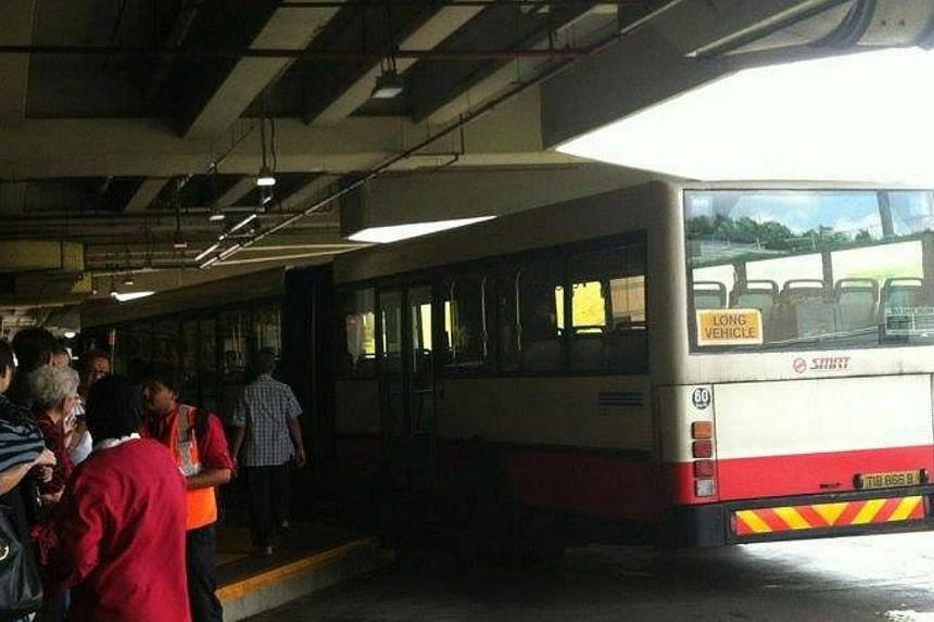 SMRT has deployed free bus services to ferry passengers between Woodlands and Yew Tee train stations along the North-South line after it detected a track fault on Saturday. -- PHOTO: LIM KEAT KENG