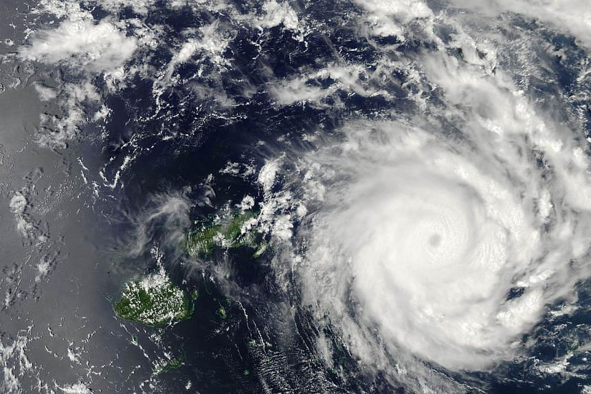 This Nasa image obtained on Jan 10, 2014 shows Tropical Cyclone Ian as it was skirting Fiji on Jan 9. The storm had winds of 157kmh, making it the equivalent of a Category 2 hurricane. -- PHOTO: AFP