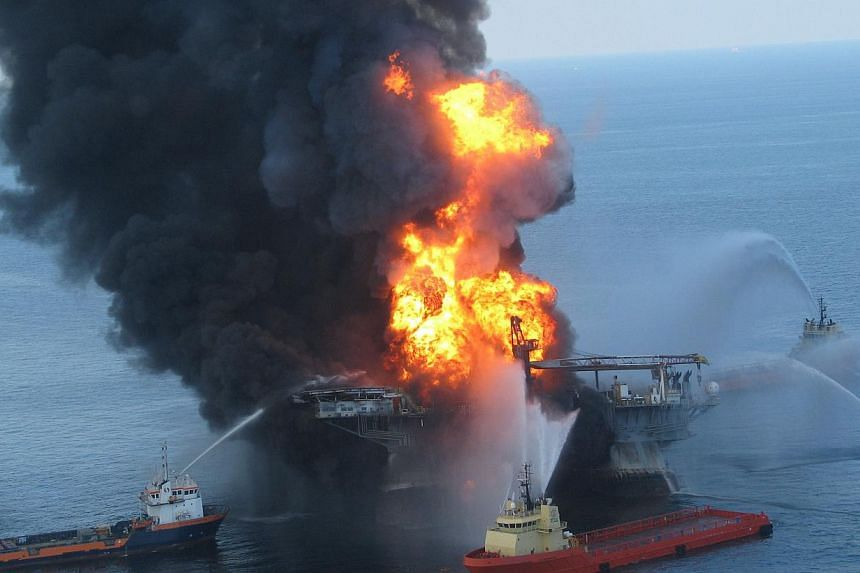 This US Coast Guard file image released on April 22, 2010 shows fire boat response crews as they battle the blazing remnants of the off shore oil rig Deepwater Horizon April 21, 2010. A US federal appeals court upheld a multibillion-dollar settlement