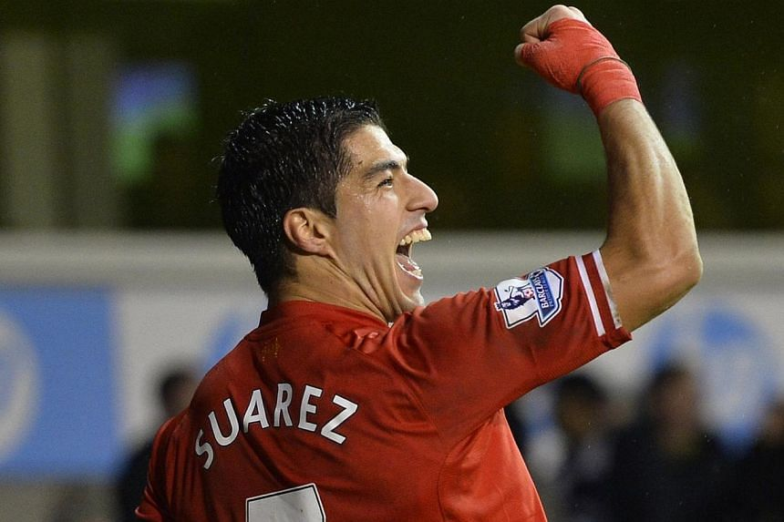 Liverpool's Luis Suarez celebrates after scoring a goal during their English Premier League soccer match against Tottenham Hotspur at White Hart Lane in London on Dec 15, 2013. Suarez insists he has finally learnt how to keep his explosive temper and