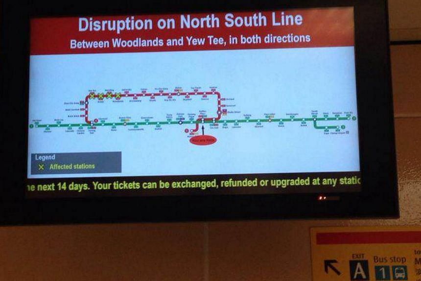 SMRT has deployed free bus services to ferry passengers between Woodlands and Yew Tee train stations along the North-South line after it detected a track fault on Saturday.-- PHOTO: ERNEST TAN