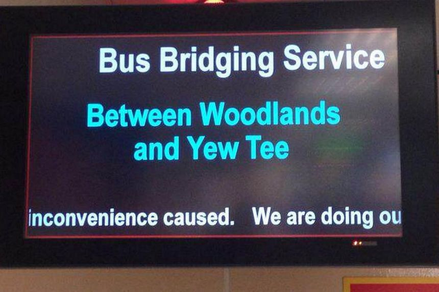 SMRT has deployed free bus services to ferry passengers between Woodlands and Yew Tee train stations along the North-South line after it detected a track fault on Saturday. -- PHOTO: ERNEST TAN